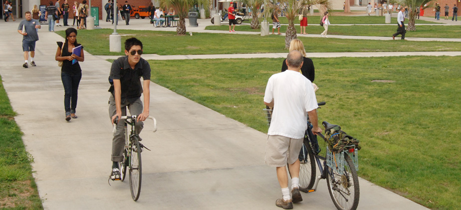 Student riding a bicycle on campus