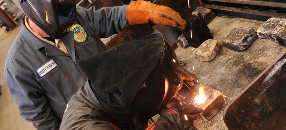 Instructor and student in welding workshop